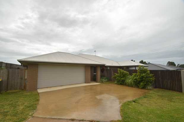 This lowset, brick home situated in Kearneys Spring is ideally located within minutes to The Univers...