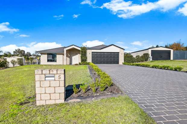 The first thing you notice upon entering this property is the sheer size of the block and the sheds....