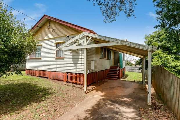 - High set timber home - 3 carpeted bedrooms (2 with built-in cupboards) - Lounge room with...