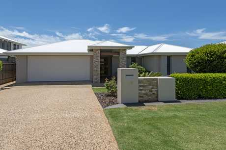 A superbly designed and inviting 5 bedroom home with massive formal lounge/entertaining, family living...