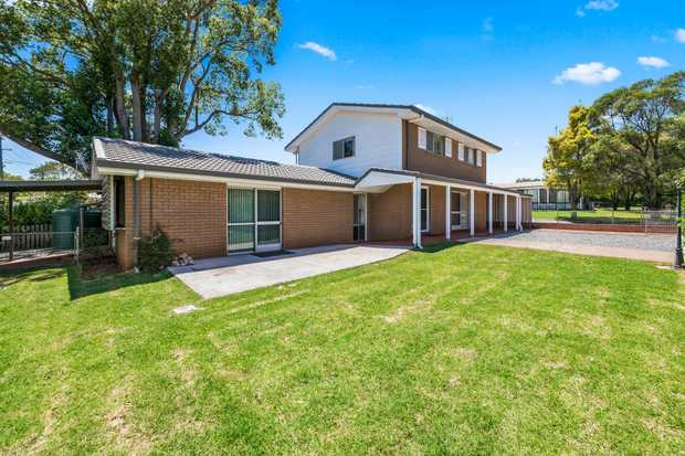 Located in Harristown within walking distance of parks and public transport sits this spacious split...