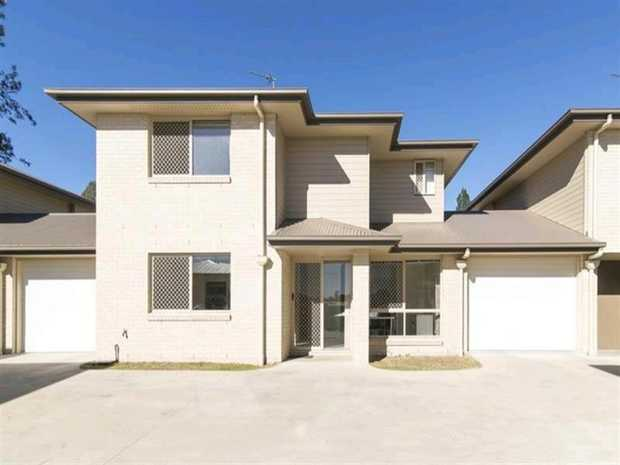 This modern townhouse located in Newtown has plenty to offer and is located close to schools, parks and...