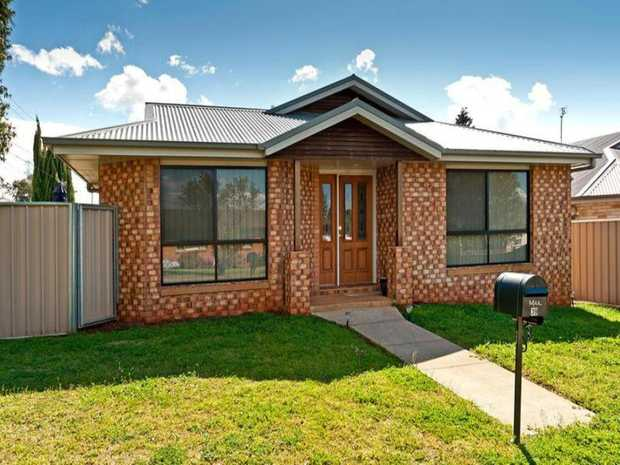 This lowset brick home is located across the road from Rockville park which is perfect for the kids!