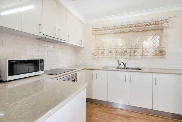A tidy and compact 2 bedroom unit, with renovated kitchen and internal access garage, round the corner...