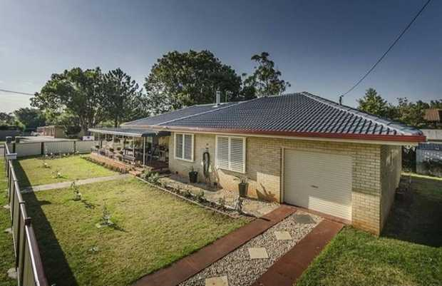 Located on the corner of Geddes Street and Erbacher Street this lovely lowset brick home is ready for...