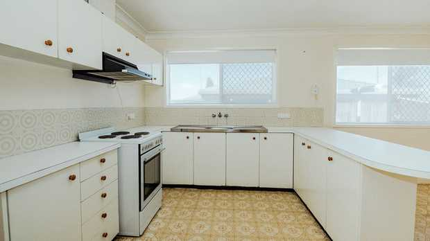 - 3 carpeted, built-in bedrooms - Large fourth bedroom/rumpus room - Tidy kitchen with electric...