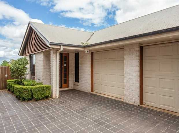 This lowset modern brick unit in a complex of 2 with contemporary design is located ideally in a quiet...