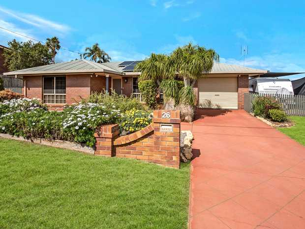 This gorgeous, welcoming home nestles perfectly into a gentle slope to offer breathtaking western...