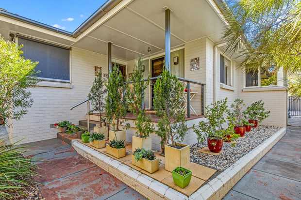 This classically stylish brick home with spacious private yard, close to the CITY and with all the...