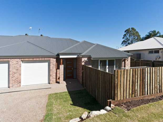 If you like to be surrounded by style and elegance, don't wait to inspect this near lowset brick duplex...