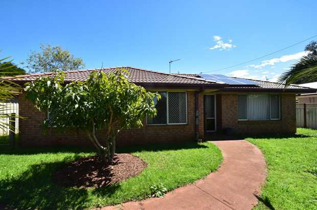 This lowset brick home offering  3 great sized bedrooms is located in popular Darling Heights is...