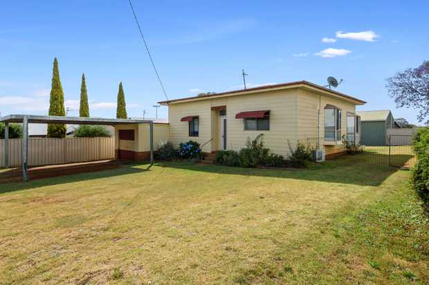 FRONT AND REAR STREET ACCESS sets this 1,960 square metre allotment with home and sheds apart.  I...