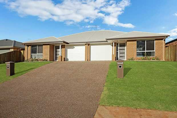 This fantastic lowset brick unit in a small complex of 2 has large living spaces complimented by masses...