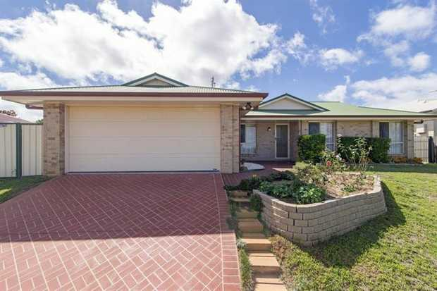 This lowset 3 bedroom family brick home is located in convenient Darling Heights, only situated minu...