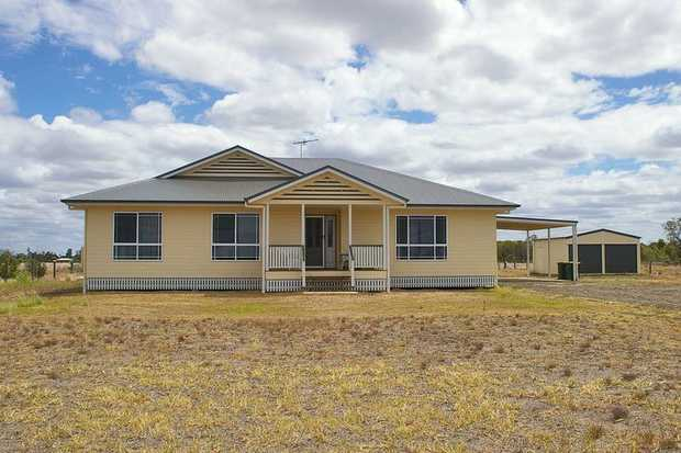 Looking for a well-priced acreage home in a top spot that you can put your mark on?  This well-designed...