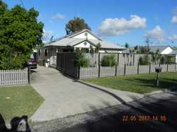 This classic Queenslander has bungalow doorway arches, lovely timber flooring, high ceilings, front...