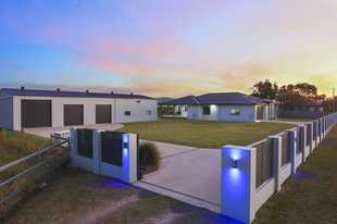 Everything you ever wanted in a property is right here - beautiful modern family home, massive shed...