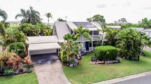 A magnificent tropical oasis set around a large in-ground pool, parking for five cars including a sh...