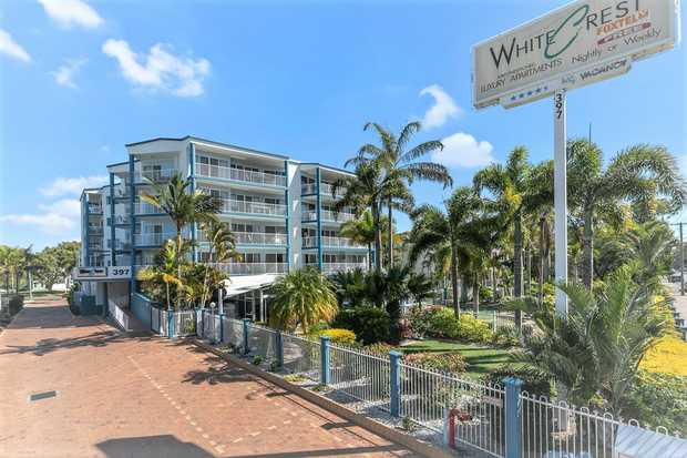 Large two bedroom unit on ground floor of Whitecrest Apartments offering large lounge/dining with...