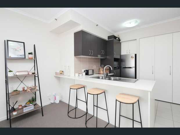 Perfect for both a savvy investor or a homeowner looking to downsize and simplify, this modern unit in...