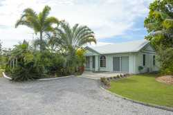 * Located in popular Pacific Ranch Estate at Tannum Sands - one flat acre in quiet cul-de-sac  * D...