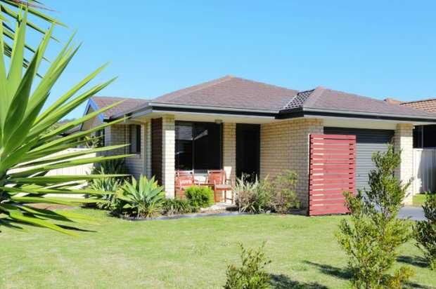 This neat and level home is located in a popular estate with a playground just down the road and Coffs...