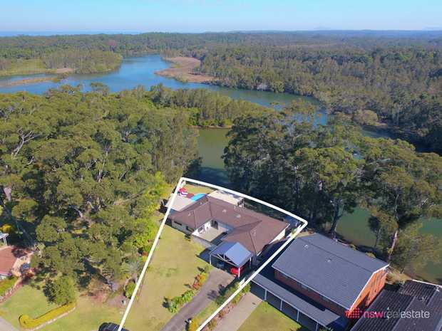 Open the gate and enter your private waterfront retreat. With uninterrupted views across Bonville Wa...