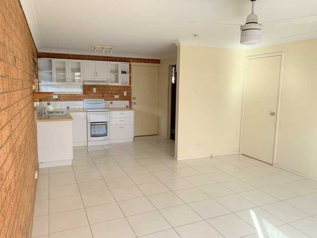 This neat and tidy private townhouse is located at the rear of a small complex, close to local shopping...