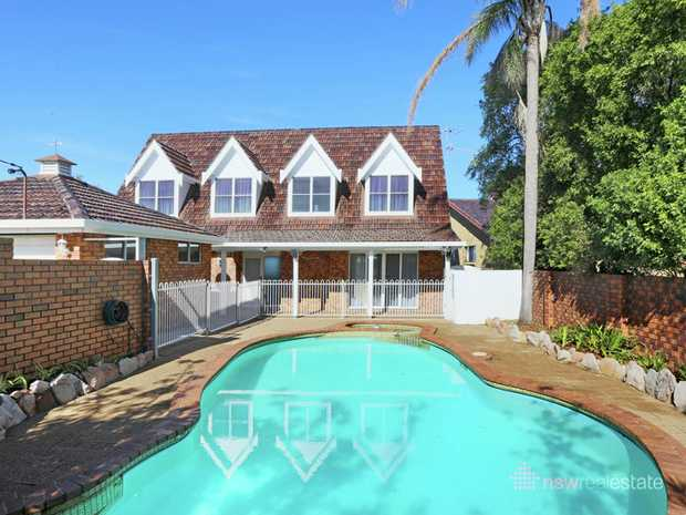 Quality and convenience never go out of style. This spacious family home features timeless cape cod...