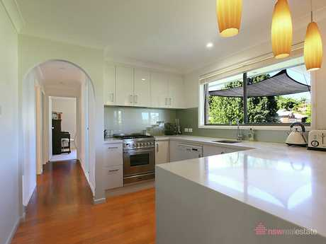 Offering an elevated position with a north facing aspect this renovated home, located in a sought after...
