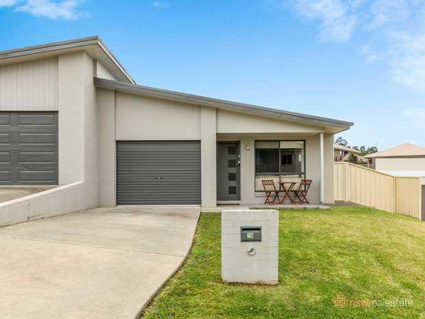 This 4 bedroom home has a formal living room, open plan meals and family room which open out onto a...