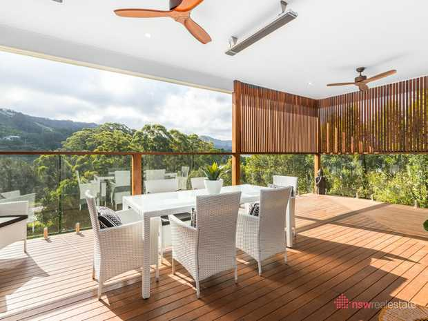 This well built and modern furnished home enjoys an elevated position in Korora with hinterland views...