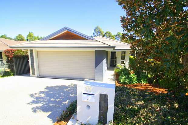 This spacious and modern home is located on a private road on Callicoma Drive in a popular family area...