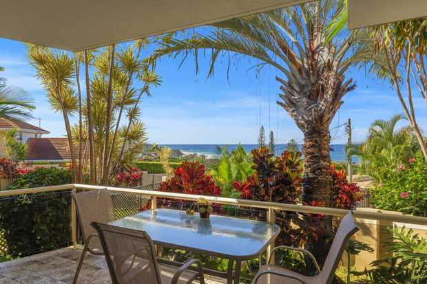 This spacious and furnished garden apartment is located at an elevated address at Sapphire Beach with...
