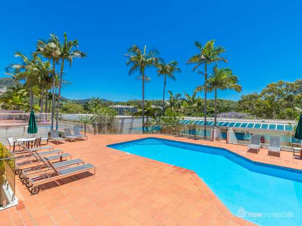 This sunny north facing terrace apartment at Pacific Bay Resort overlooks a large resort style pool and...