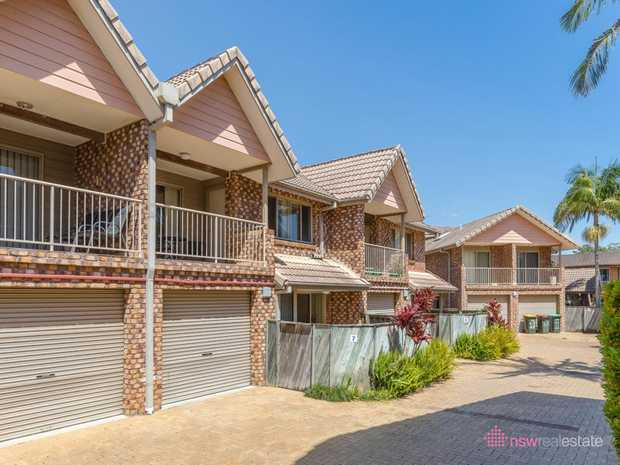 This centrally located north facing townhouse is only a short walk to local shopping centres and the...