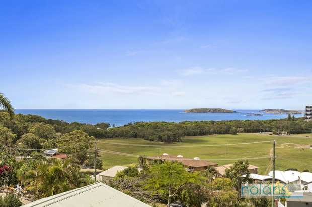 Located in one of Coffs Harbours premier streets this unique family home offers million dollar ocean...