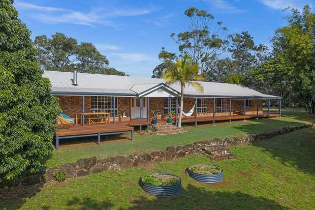 Picturesque and private, this immaculate family home is situated on an elevated 3.97acre piece of land...