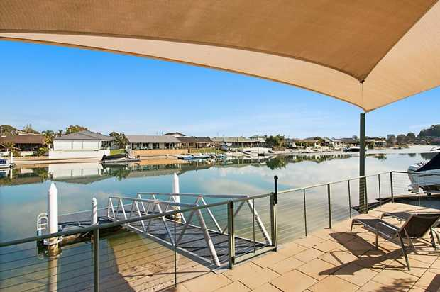 Your dream lifestyle awaits, complete with your own boat ramp and pontoon for all your boating needs...
