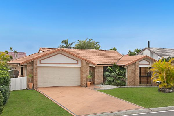 Surrounded by established gardens, this immaculately maintained family residence provides a versatil...