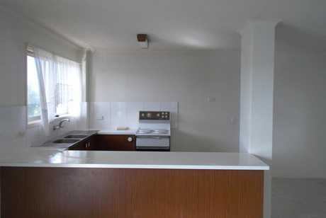 Newly carpeted two bedroom unfurnished unit with one bathroom, open plan design in living and dining...