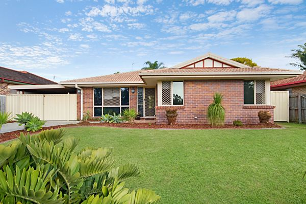 In a highly sought after, central Banora Point location this quality brick and tile home offers...
