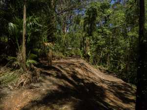 Secluded acreage within an 8 minute drive to the beach, shops and amenities