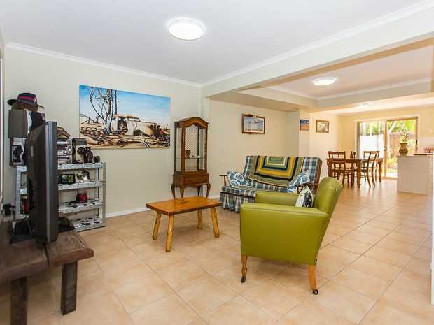 You'll enjoy walking in to this tastefully renovated townhouse with three good size bedrooms, one fully...