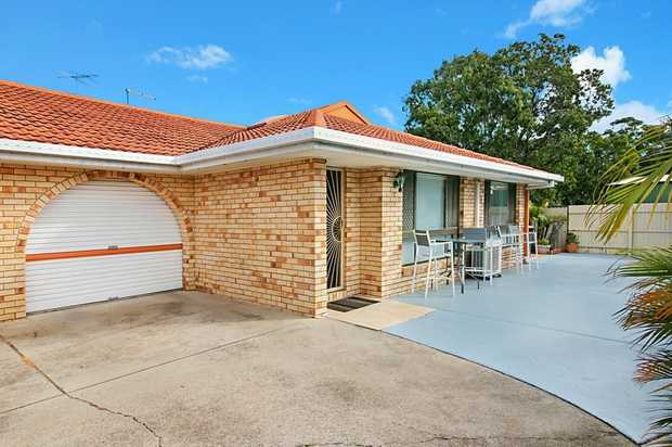 This well-maintained duplex offers privacy and comfort in a popular location.  Brick and tile, the...