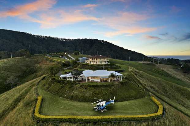 Set high on its 10-acre parcel to command a cinematic Coffs Harbour, mountain and ocean vista from...