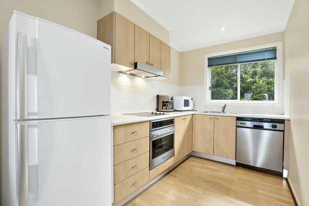 This spacious two bedroom, two bathroom, three toilet townhouse is in the Aqua Luna complex on fabulous...