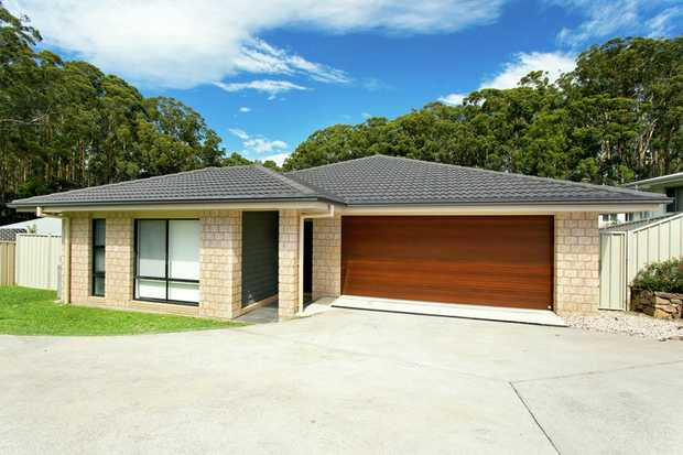Sleek, modern and stylish, this North Bonville home will appeal to those who love a little designer...