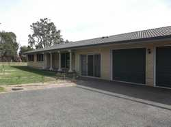 Located in a quiet corner position overlooking the town area and opposite a parkland reserve, this h...