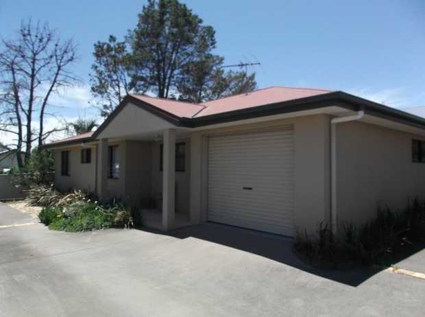 3 bedroom brick unit with 2 bathrooms, good size open plan living area, electric kitchen, attached...
